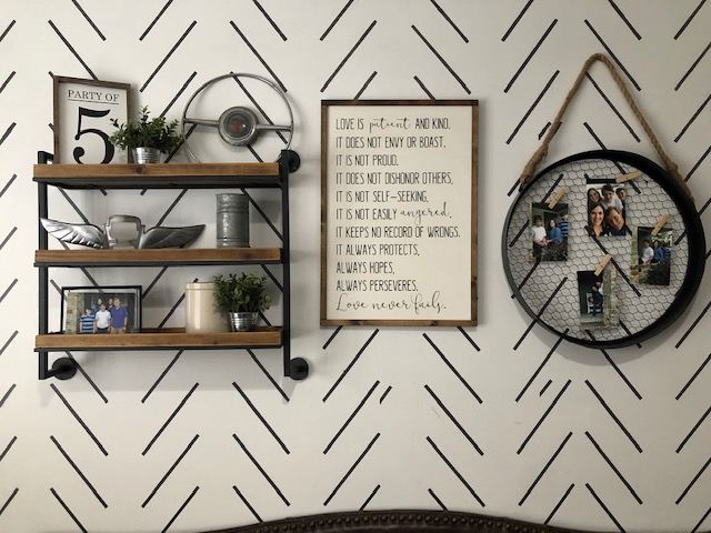 wood and metal shelves and 1 corinthians 13 sign